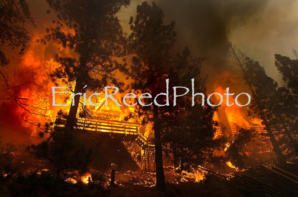 The Grass Fire ravages its way into the Lake Arrowhead area of  Grass Valley Lake and The Lake Arrowhead Country Club as firefighters from all over the inland empire attack fire and defend homes, Oct. 22, 2007. Eric Reed Photographer