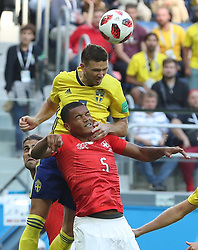SAINT PETERSBURG, July 3, 2018  Manuel Akanji (bottom) of Switzerland competes for a header with Marcus Berg of Sweden during the 2018 FIFA World Cup round of 16 match between Switzerland and Sweden in Saint Petersburg, Russia, July 3, 2018. Sweden won 1-0 and advanced to the quarter-final. (Credit Image: © Cao Can/Xinhua via ZUMA Wire)