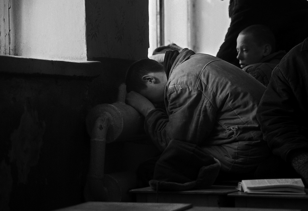 Russian juvenile prisoners warm hirself on the rest room of the colony for prisoner's children in Siberian town Leninsk-Kuznetsky, Russia, 25 January 1999.