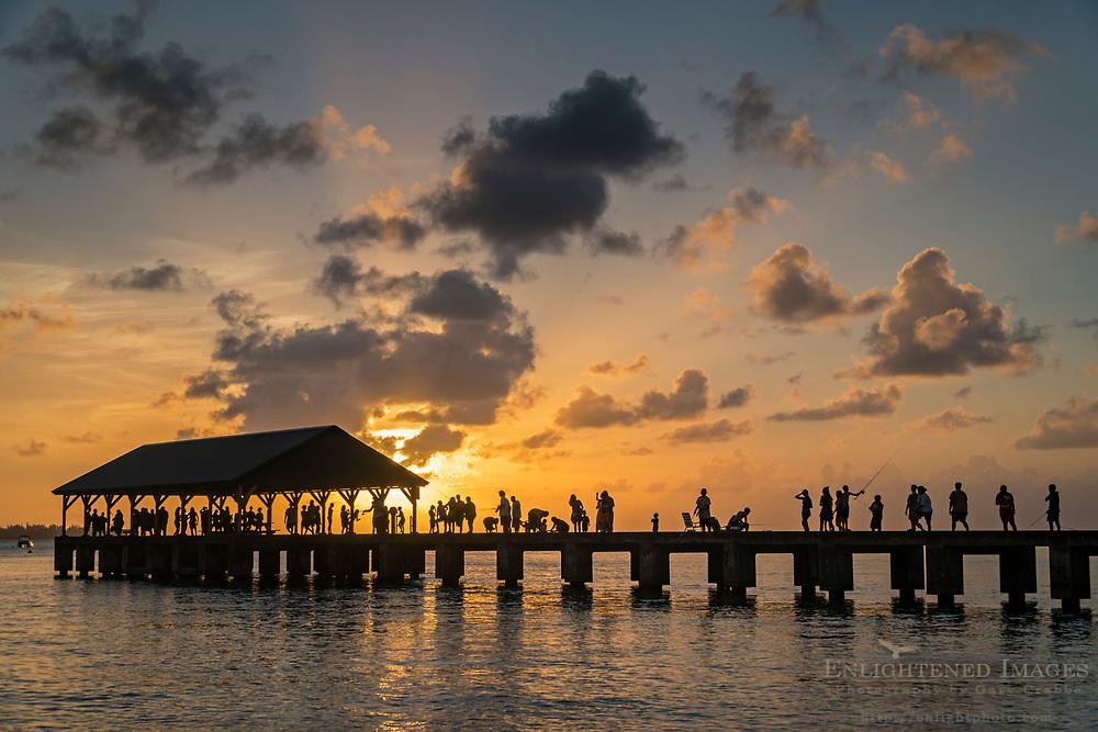 People enjoying the sunset on the Hanalei Pier, Hanalei, Kauai, Hawaii