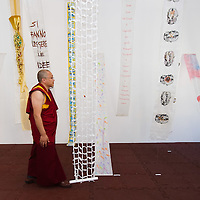 "VENICE, ITALY - JUNE 04:  A Tibetan Monk looks walks through works by several artisits at ""The Pavillion Tibet"" a project by Ruggero Maggi on June 4, 2011 in Venice, Italy. The Venice Art Biennale will run from June 4 to November 27, 2011."