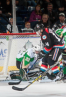 KELOWNA, CANADA - NOVEMBER 12: Ian Scott #33 of the Prince Albert Raiders makes a save on a shot by Jake Kryski #14 of the Kelowna Rockets on November 12, 2016 at Prospera Place in Kelowna, British Columbia, Canada.  (Photo by Marissa Baecker/Shoot the Breeze)  *** Local Caption *** Ian Scott; Jake Kryski