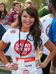 Lizzie Cundy taking part in a one mile run for Sport Relief charity in London, 25th March 2012.  Photo by: i-Images