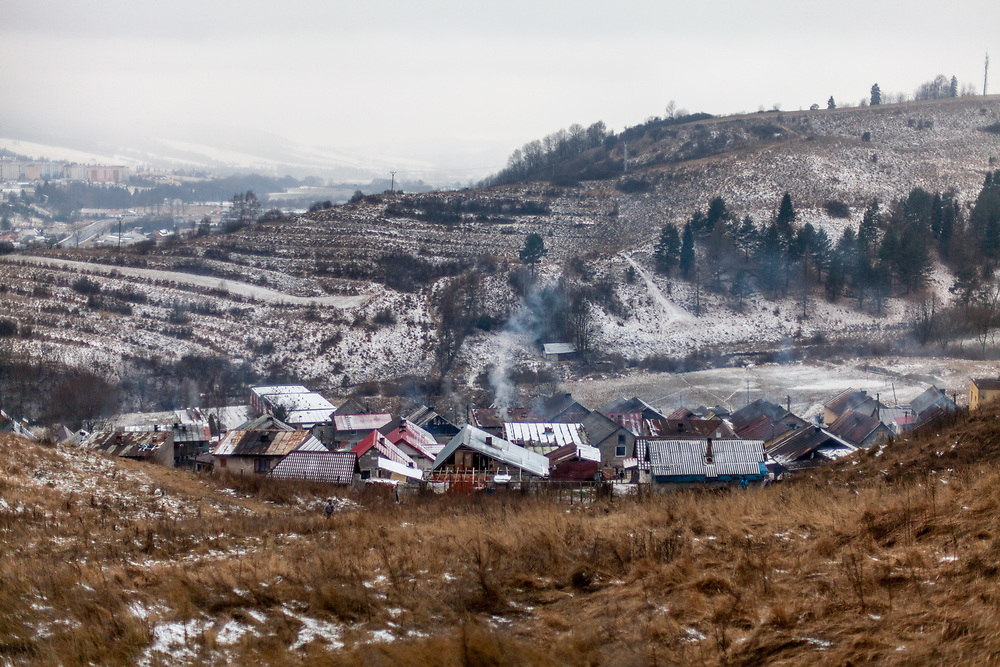"""The Roma part of the district """"Podsadek"""" in eastern Slovakia, located in a little valley. The city of Stara Lubovna (in the back) is located about 100 km from Kosice in northeast Slovakia. The town has a population of 16350, of whom 2 060 (13%) are of Roma origin. The majority of Roma live in the Podsadek district, where 980 (74%) out of 1330 inhabitants are Roma."""