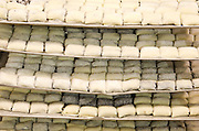 Raw dough on trays before baking in an industrial bakery