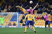 Northampton Town midfielder Jason Taylor wins the ball in the air during the Sky Bet League 2 match between Mansfield Town and Northampton Town at the One Call Stadium, Mansfield, England on 28 March 2016. Photo by Jon Hobley.