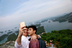 A gay couple takes a selfie at a Saikai National Park during a stopover of    a cruise organised by the Parents and Friends of Lesbians and Gays (PFLAG) China organisation at Sasebo, Nagasaki, Japan, 16 June 2017. About 800 members of the Chinese LGBT (lesbian, gay, bisexual and transgender) community and their parents spent four days on a cruise trip organised by Parents and Friends of Lesbians and Gays (PFLAG) China, a grassroots non-government organisation, celebrating the 10th anniversary of the organisation. It aims to promote coexistence among homosexuals and their families.