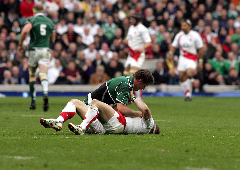 Ronan O'Gara fights with Jamie Noon during the RBS Six Nations game between England and Ireland at Twickenham Stadium, Twickenham, 15th March 2008.