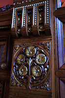 Intricately carved woodword within the Antoni Gaudi designed Palau Guell in Barcelona, Spain