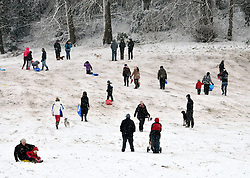 © Licensed to London News Pictures. 18/01/2013. Bristol, UK. Heavy snow provides a winter playground for people to enjoy at Arnos Court Park in Bristol. 18 January 2013..Photo credit : Simon Chapman/LNP