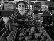 07 AUGUST 2017 - KECAMATAN, BALI, INDONESIA: A vender puts out duck eggs she sells in the market in Kecamatan, in eastern Bali. Bali's local markets are open on an every three day rotating schedule because venders travel from town to town. Before modern refrigeration and convenience stores became common place on Bali, markets were thriving community gatherings. Fewer people shop at markets now as more and more consumers go to convenience stores and more families have refrigerators.     PHOTO BY JACK KURTZ