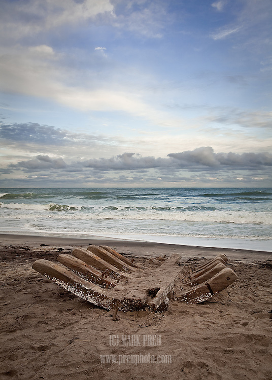 A piece from the hull of an old wreck washed up on Nauset beach during a November 2010 nor'easter. According to maritime historian William Quinn, it is likely to be a piece of the schooner Montclair, which broke up during a storm in 1927. This image was created on Christmas Day,2010.