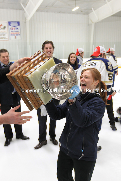 TORONTO, ON - Apr 22, 2015 : Ontario Junior Hockey League game action between the Toronto Patriots and the Kingston Voyageurs. Game seven of the Buckland Cup Championship Series.Toronto Patriots Team Doctor Raises the Cup.<br /> (Photo by Tim Bates / OJHL Images)