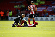 John Fleck of Sheffield United goes down injured during the Premier League match between Sheffield United and Crystal Palace at Bramall Lane, Sheffield, England on 18 August 2019.