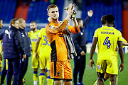 AFC Wimbledon goalkeeper George Long (1), on loan from Sheffield United, applauds the AFC Wimbledon fans during the EFL Sky Bet League 1 match between Oldham Athletic and AFC Wimbledon at Boundary Park, Oldham, England on 21 November 2017. Photo by Simon Davies.