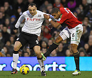 Picture by David Horn/Focus Images Ltd +44 7545 970036.29/12/2012.Dimitar Berbatov of Fulham holds off the challenge of Ashley Williams of Swansea City during the Barclays Premier League match at Craven Cottage, London.