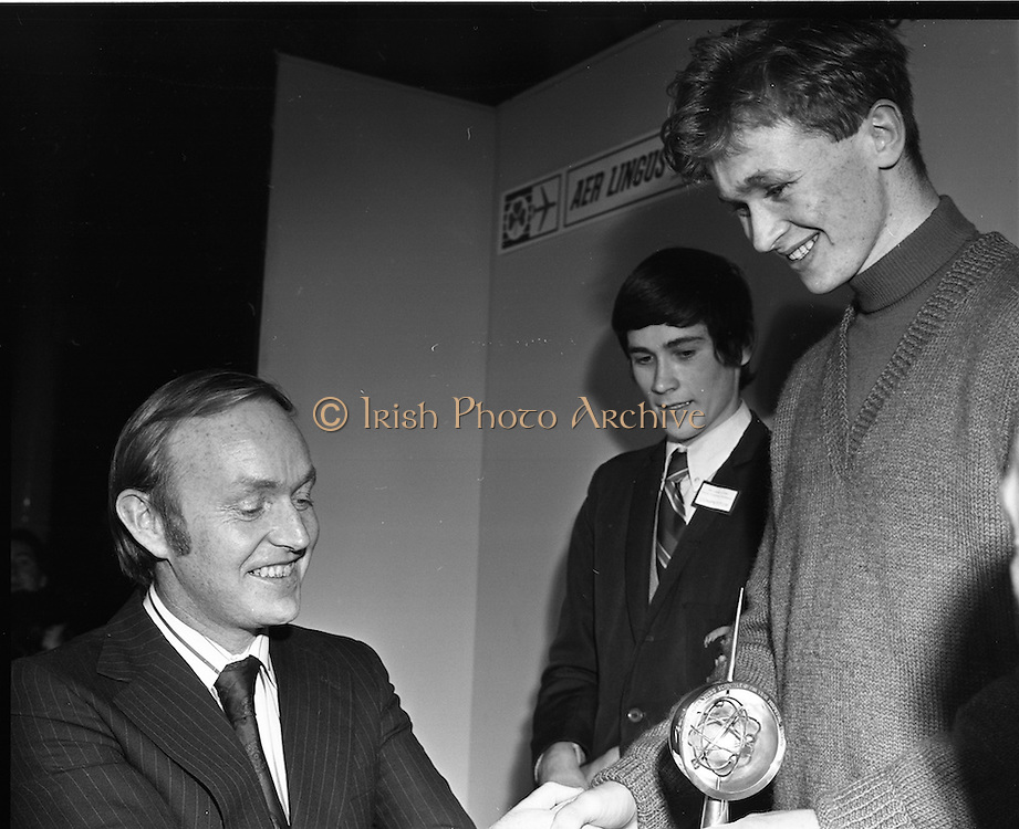 1973.5/1/73.1/5/73.5th January 1973 .The Aer Lingus Young Scientist Exhibition at the RDS, Dublin ..Michael O'Kennedy, T.D., Minister for Transport and Power presenting the trophy to the winner of the Young Scientist of the year, Tadhg O'Beaglaoich from North Monastery CBS Cork. ..