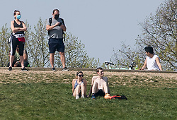 © Licensed to London News Pictures. 11/04/2020. London, UK. People sunbathing on Primrose Hill, London on Easter Bank holiday weekend, during a pandemic outbreak of the Coronavirus COVID-19 disease. The public have been told they can only leave their homes when absolutely essential, in an attempt to fight the spread of coronavirus COVID-19 disease. Photo credit: Ben Cawthra/LNP