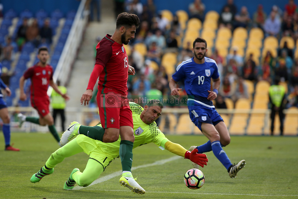 June 3, 2017 - Lisbon, Portugal - Portugal's midfielder Andre Gomes vies with Cypruss goalkeeper Antonis Giorgallidis (C ) during the friendly football match Portugal vs Cyprus at Antonio Coimbra da Mota Stadium in Estoril, outskirts of Lisbon, Portugal on June 3, 2017. (Credit Image: © Pedro Fiuza/NurPhoto via ZUMA Press)