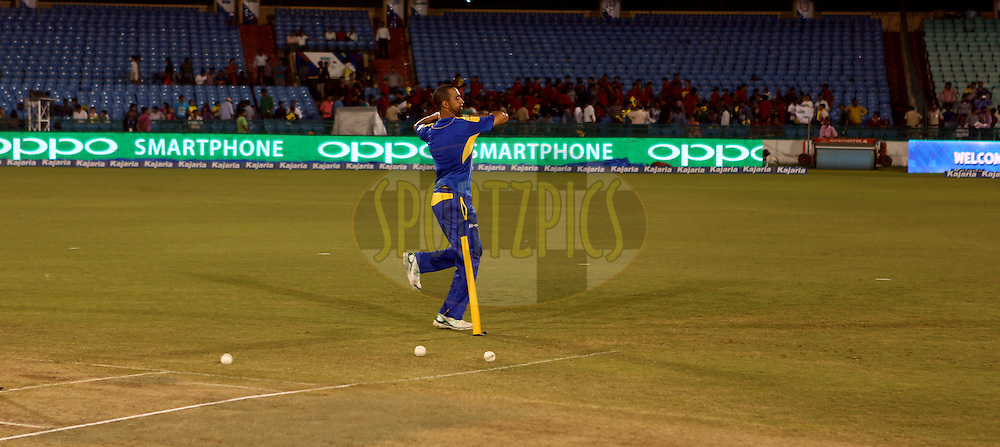 Players of Cape Cobras warm up before the start of the  match 3 of the Oppo Champions League Twenty20 between the Cape Cobras and the Northern Knights held at the Chhattisgarh International Cricket Stadium, Raipur, India on the 19th September 2014<br /> <br /> Photo by:  Sandeep Shetty / Sportzpics/ CLT20<br /> <br /> <br /> Image use is subject to the terms and conditions as laid out by the BCCI/ CLT20.  The terms and conditions can be downloaded here:<br /> <br /> http://sportzpics.photoshelter.com/gallery/CLT20-Image-Terms-and-Conditions-2014/G0000IfNJn535VPU/C0000QhhKadWcjYs