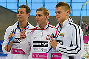 Poland's Radoslaw Kawecki (c) wins gold, Israel's Yan Yakov Toumarkin (l) wins silver and Lithuania's Danas Rapsys wins bronze in the 200m Backstroke during Day 13 of the 2016 LEN European Aquatics Championship Swimming Finals at the London Aquatics Centre, London, United Kingdom on 21 May 2016. Photo by Martin Cole.