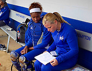 Hampton University Assistant Coach Lisa Jansen goes over the lineup with catcher Brook Boykin prior Hampton's doubleheader split against Morgan State University at the Lady Pirates Softball Complex on the campus of Hampton University in Hampton, Virginia.  (Photo by Mark W. Sutton)
