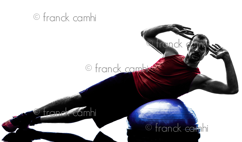 one man exercising fitness bosu balance trainer  in silhouette isolated on white background