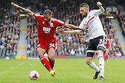 Birmingham City midfielder David Davis (26) keeps the ball from Fulham defender Scott Malone (3) during the EFL Sky Bet Championship match between Fulham and Birmingham City at Craven Cottage, London, England on 10 September 2016. Photo by Andy Walter.