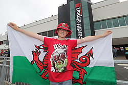 CARDIFF, WALES - Saturday, June 4, 2016: Alfie Davies, 9, from Barry, flies the Welsh flag as he waits to give the Wales team a colourful send off at Cardiff Airport as the squad head to Sweden for their last friendly before the UEFA Euro 2016 in France. (Pic by David Rawcliffe/Propaganda)
