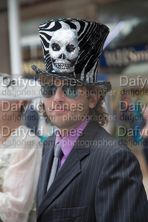 JAMIE DE'ATH WEARING  FISHHEAD HAT BY ANDREW FISH, Royal Ascot racegoers at Waterloo station. London. 19 June 2013.