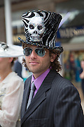 JAMIE DE'ATH WEARING  FISHHEAD HAT BY ANDREW FISH, Royal Ascot racegoers at Waterloo station. London. 19 June 2013.