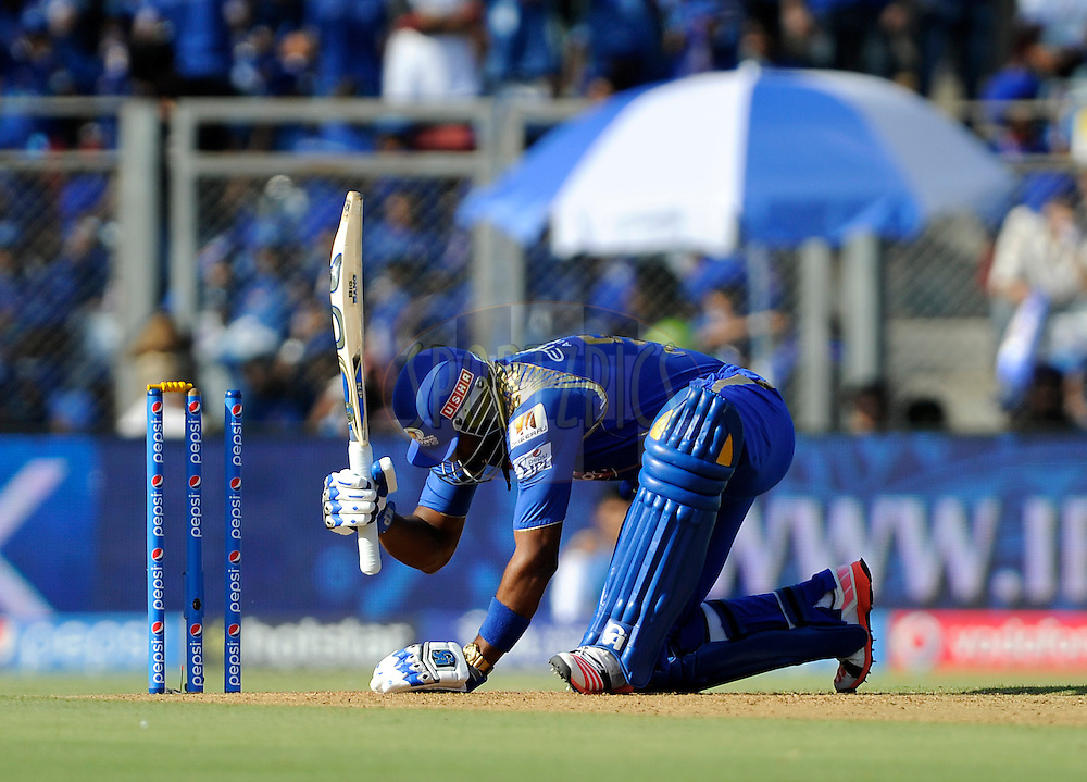 Kieron Pollard of Mumbai Indians gets ready to bat during match 23 of the Pepsi IPL 2015 (Indian Premier League) between The Mumbai Indians and The Sunrisers Hyferabad held at the Wankhede Stadium in Mumbai India on the 25th April 2015.<br /> <br /> Photo by:  Pal Pillai / SPORTZPICS / IPL
