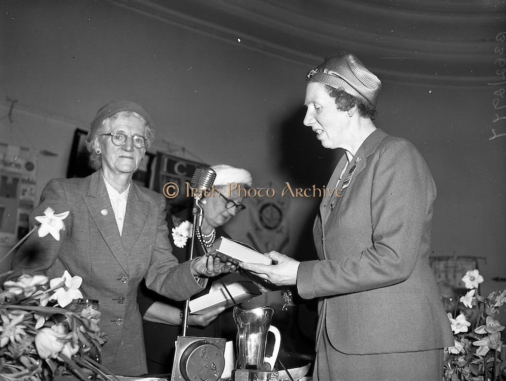 21/04/1960<br /> 04/21/1960<br /> 21 April 1960<br /> Golden Jubilee of the I.C.A.. The Annual General Meeting of the Irish Countrywomen's Association at the Mansion House, Dublin. Picture shows Miss Alice M. Ryan (left) Buan Cara I.C.A. presenting the 1st Prize in the Summer Section of the Inter-Federation Competition to Mrs L. Becher, President Skibereen Guild I.C.A.. Mrs Dorothy Smith, President I.C.A. is in the centre.