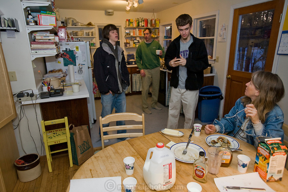 Lobsterman and fish buyer Sam Tucker discusses plans for the day with his family and his home on Great Diamond Island, Maine (Samuel Tucker is featured in the book What I Eat: Around the World in 80 Diets.) MODEL RELEASED.