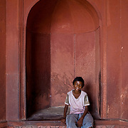 This young boy poses for a picture in the arch found inside the front main gate of the Jamma Masjid.