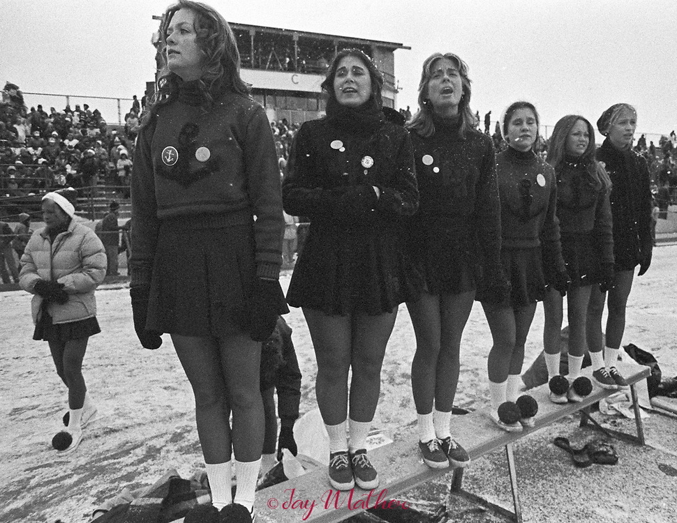 John F. Kennedy High School varsity cheerleaders realize their football team is going to lose the 1975 Class AAA championship to Mitchell High School. The game played at the Denver metro field ended in favor of Mitchell, 9-0.