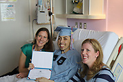 Madison HS senior Erick Reyes with his doctors after receiving his high school diploma at Texas Children's Hospital.