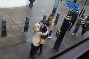 A couple kiss at a bus stop in Whitehall, Westminster, on 9th April 2019, in London, England.
