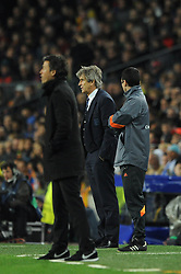 Manchester City Manager, Manuel Pellegrini cuts a dejected figure - Photo mandatory by-line: Dougie Allward/JMP - Mobile: 07966 386802 - 18/03/2015 - SPORT - Football - Barcelona - Nou Camp - Barcelona v Manchester City - UEFA Champions League - Round 16 - Second Leg