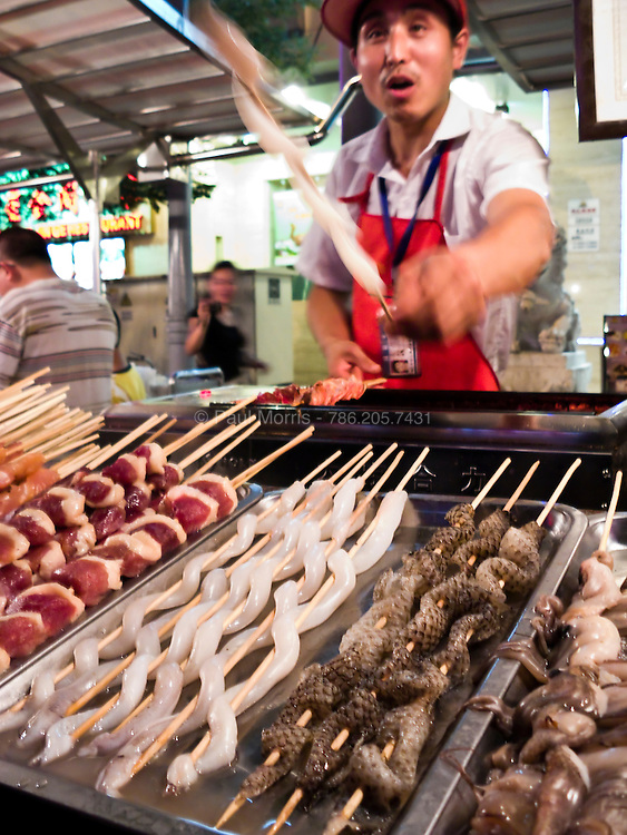 The famous Beijing Wangfujing Night Market where you can find everything from Sea Snakes to Silk Worms grilled on a stick.