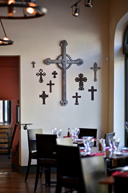 Decorative crosses hanging on the walls at Nuevo Modern Mexican & Tequila Bar.