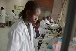 Staff at Juba Teaching Hospital in South Sudan examine lab results.