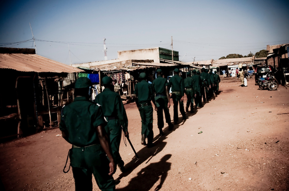 A security team patrols the morning streets in the Southern Sudanese town of Aweil. Sudan recently voted on whether or not to remain with the North or to set out alone as the world's newest nation. (© William B. Plowman)