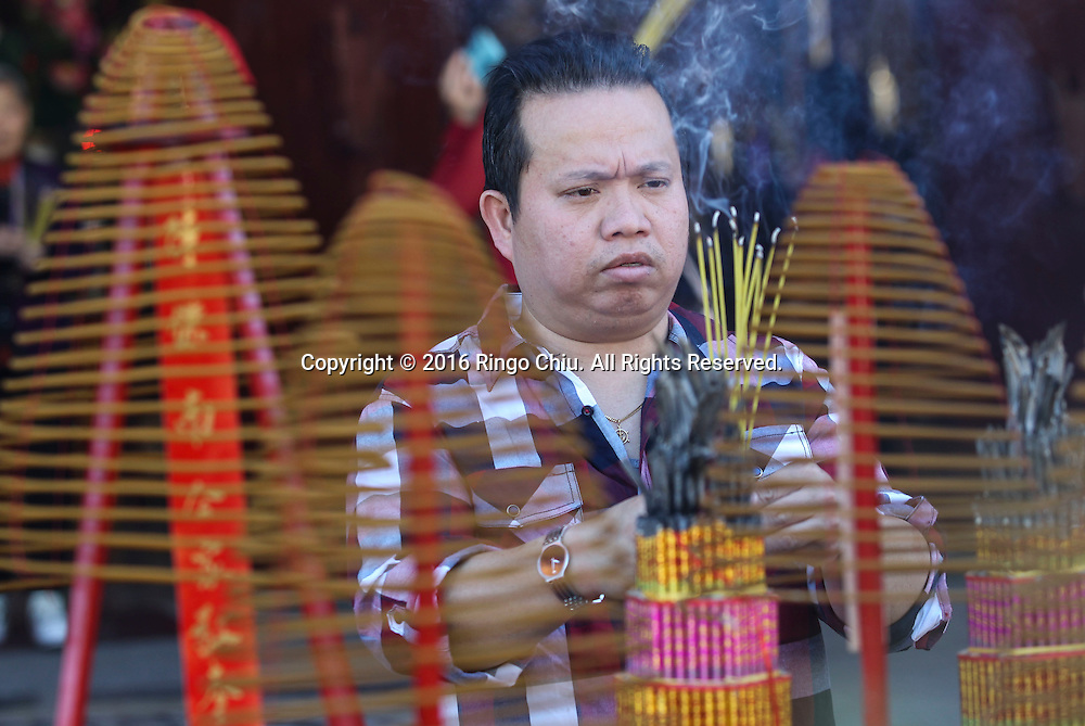 A man prays at the Thien Hau temple to celebrate the first day of the Chinese Lunar New Year, the Year of the Monkey, on Monday February 8, 2016, in Los Angeles.(Photo by Ringo Chiu/PHOTOFORMULA.com)<br /> <br /> Usage Notes: This content is intended for editorial use only. For other uses, additional clearances may be required.