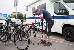 A Cervélo-Bigla Cycling Team mechanic checks the tyre pressure for each bike before Stage 1 of the Emakumeen Bira - a 50 km road race, starting and finishing in Iurreta on May 16, 2017, in Basque Country, Spain.