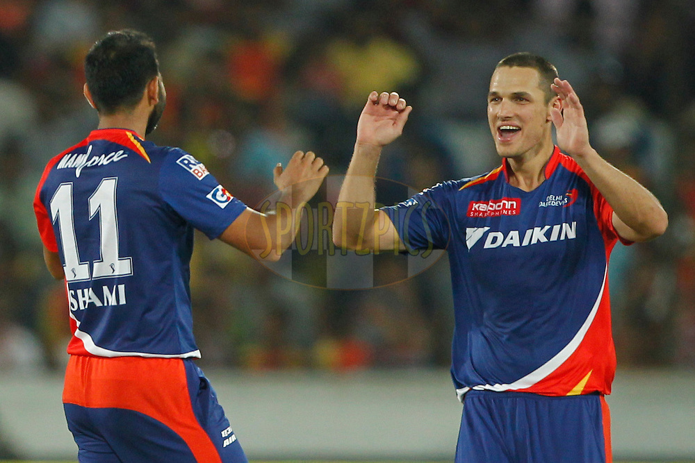 Mohammed Shami of Delhi Daredevils and Nathan Coulter-Nile of Delhi Daredevils celebrates the wicket of Moises Henriques of Sunrisers Hyderabad during match 42 of the Vivo IPL 2016 (Indian Premier League ) between the Sunrisers Hyderabad and the Delhi Daredevils held at the Rajiv Gandhi Intl. Cricket Stadium, Hyderabad on the 12th May 2016<br /> <br /> Photo by Deepak Malik / IPL/ SPORTZPICS