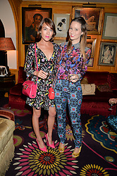 Left to right, ELLA CATLIFF and KELLY EASTWOOD at an exclusive dinner for Iris Apfel held at Annabel's, Berkeley Square, London on 29th July 2015.