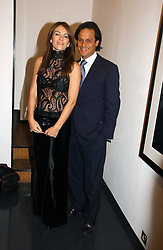 LIZ HURLEY and ARUN NAYAR at a private view of an exhibition of portrait photographs by Danish photographer Marc Hom held at the Hamiltons Gallery, 13 Carlos Place, London on 23rd October 2006.<br /><br />NON EXCLUSIVE - WORLD RIGHTS