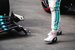 November 17, 2019, SãO Paulo, Brazil: SÃO PAULO, SP - 17.11.2019: GRANDE PRÊMIO DO BRASIL F1 2019 - Lewis Hamilton (GBR) observes damage to his car after finishing third at the Brazilian Formula 1 2019 Grand Prix, held at the Interlagos Circuit in Sao Paulo, SP. (Credit Image: © Victor EleutéRio/Fotoarena via ZUMA Press)