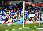 A header from Bournemouth Defender Tommy Elphick (5) brings the score back to 2-1 during the Barclays Premier League match between Bournemouth and Chelsea at the Goldsands Stadium, Bournemouth, England on 23 April 2016. Photo by Adam Rivers.